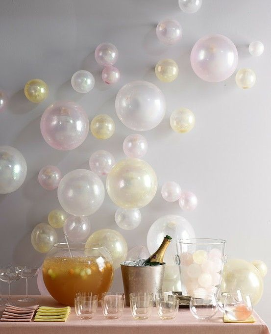Balloons blown up to different sizes and just taped to the wall to look like bubbles. How cute is this!!